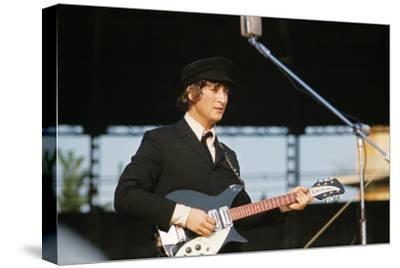 John Lennon Playing Guitar--Stretched Canvas Print