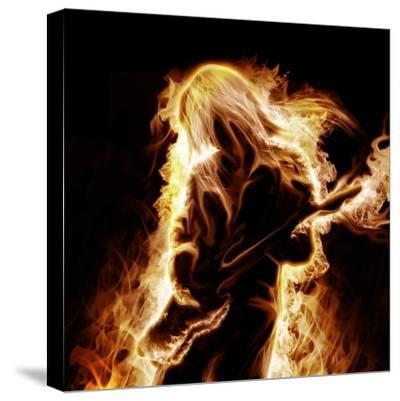 Musician With An Electronic Guitar Enveloped In Flames On A Black Background-Sergey Nivens-Stretched Canvas Print