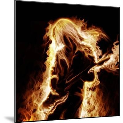 Musician With An Electronic Guitar Enveloped In Flames On A Black Background-Sergey Nivens-Mounted Premium Giclee Print