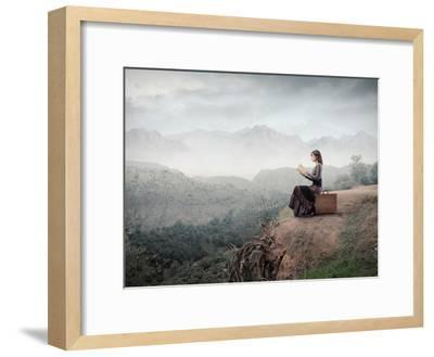Woman Sitting On A Suitcase And Reading A Book With Landscape On The Background-olly2-Framed Premium Giclee Print