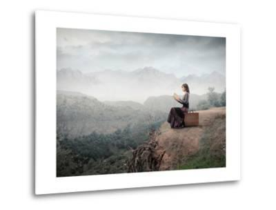 Woman Sitting On A Suitcase And Reading A Book With Landscape On The Background-olly2-Metal Print