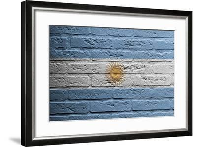 Brick Wall With A Painting Of A Flag, Argentina-Micha Klootwijk-Framed Art Print