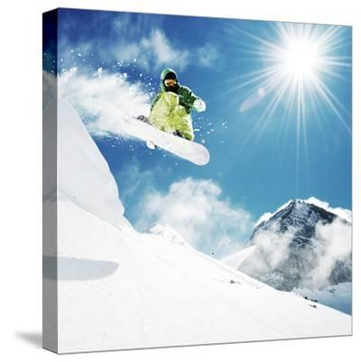 Snowboarder At Jump Inhigh Mountains At Sunny Day-dellm60-Stretched Canvas Print