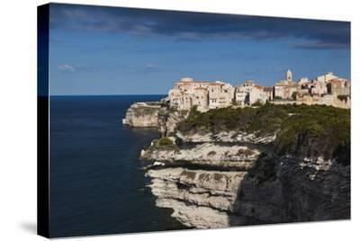 Elevated View of City and Cliffs, Bonifacio, Corsica, France-Walter Bibikow-Stretched Canvas Print