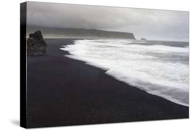 Basalt Column Rises from Black Sand Beach on Rainy Day, Vik, Iceland-Jaynes Gallery-Stretched Canvas Print