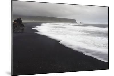 Basalt Column Rises from Black Sand Beach on Rainy Day, Vik, Iceland-Jaynes Gallery-Mounted Photographic Print