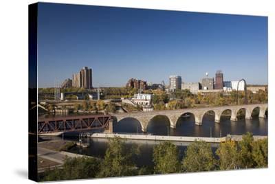 Mississippi River and City Skyline, Minneapolis, Minnesota, USA-Walter Bibikow-Stretched Canvas Print