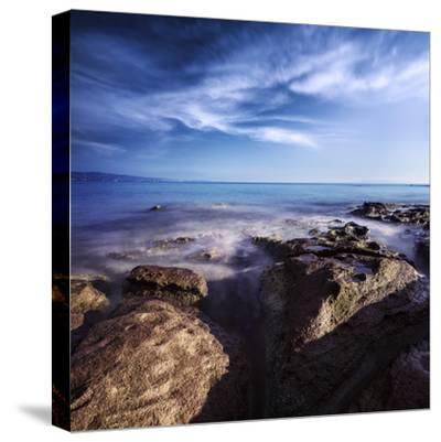 Rocky Shore and Tranquil Sea, Portoscuso, Sardinia, Italy--Stretched Canvas Print