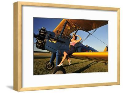 1940's Style Pin-Up Girl Sitting on the Wing of a Stearman Biplane--Framed Photographic Print