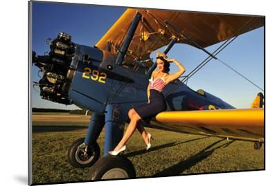 1940's Style Pin-Up Girl Sitting on the Wing of a Stearman Biplane--Mounted Photographic Print