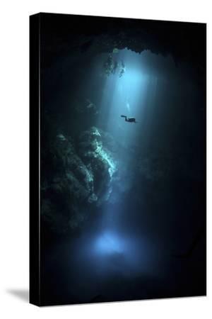 Scuba Diver Descends into the Pit Cenote in Mexico--Stretched Canvas Print