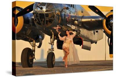 Sexy 1940's Pin-Up Girl in Lingerie Posing with a B-25 Bomber--Stretched Canvas Print