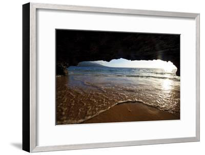 The Lip of a Foamy Wave Laps a Sandy Beach Inside an Ocean Cave-Jason Edwards-Framed Premium Photographic Print