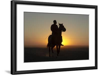 A Silhouetted Man on Horseback at Sunset-Beverly Joubert-Framed Photographic Print