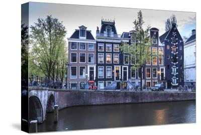 Old Gabled Houses Line the Keizersgracht Canal at Dusk, Amsterdam, Netherlands, Europe-Amanda Hall-Stretched Canvas Print