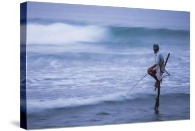Stilt Fishing, a Stilt Fisherman in the Waves at Midigama Near Weligama, South Coast-Matthew Williams-Ellis-Stretched Canvas Print
