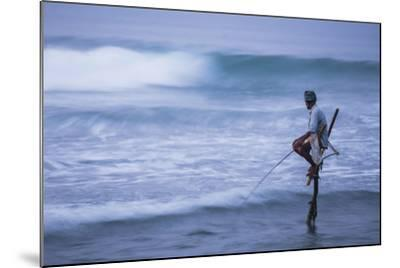 Stilt Fishing, a Stilt Fisherman in the Waves at Midigama Near Weligama, South Coast-Matthew Williams-Ellis-Mounted Photographic Print