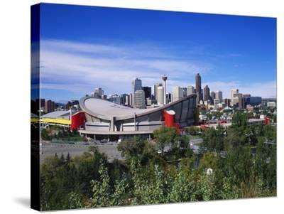 Saddledome and Skyline of Calgary, Alberta, Canada,-Hans Peter Merten-Stretched Canvas Print