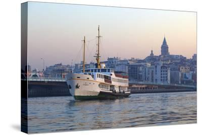 Ferry Boat in Golden Horn with Galata Tower in Background, Istanbul, Turkey, Europe-Neil Farrin-Stretched Canvas Print
