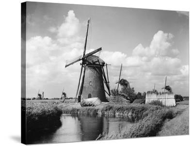 Canalside Windmills--Stretched Canvas Print