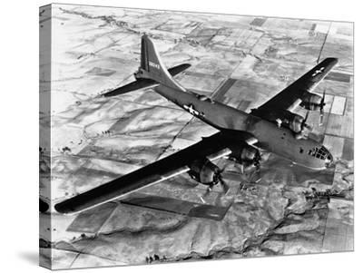 B-29 Flying over Japan's Countryside--Stretched Canvas Print