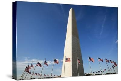American Flags Encircling Washington Monument-Paul Souders-Stretched Canvas Print
