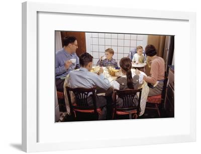 Family Eating Together at Dinner Table-William P^ Gottlieb-Framed Premium Photographic Print