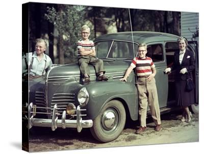 A Family Poses on and around their Plymouth Automobile, Ca. 1953--Stretched Canvas Print
