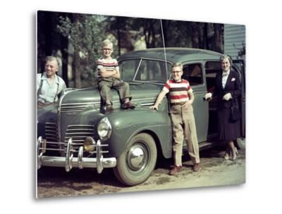 A Family Poses on and around their Plymouth Automobile, Ca. 1953--Metal Print