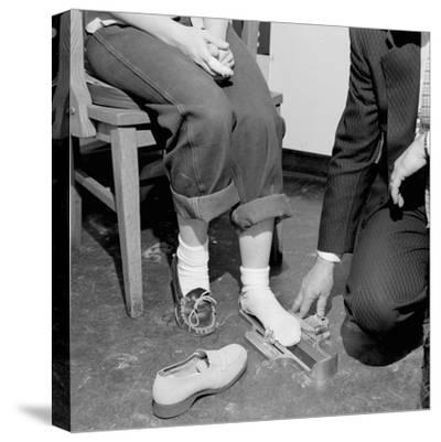 Salesmen Helps Woman with Safety Work Shoes, Ca. 1943--Stretched Canvas Print
