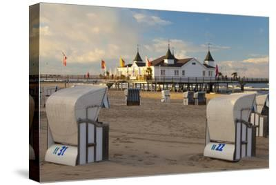 Beach Chairs and the Historic Pier in Ahlbeck on the Island of Usedom-Miles Ertman-Stretched Canvas Print