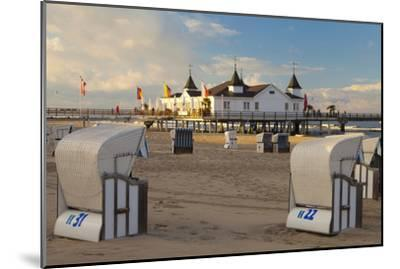 Beach Chairs and the Historic Pier in Ahlbeck on the Island of Usedom-Miles Ertman-Mounted Photographic Print