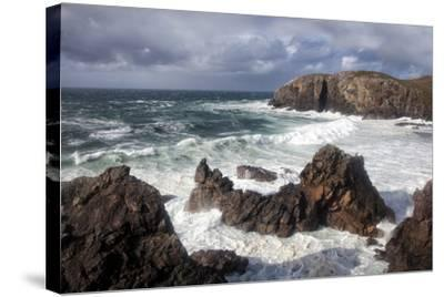 Heavy Seas Pounding the Rocky Coastline at Dalbeg-Lee Frost-Stretched Canvas Print
