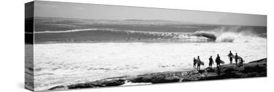 Silhouette of Surfers Standing on the Beach, Australia--Stretched Canvas Print