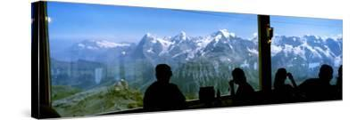 Tourists at Schilthorn 007 Restaurant with Mt Eiger Mt Monch Mt Jungfrau in the Background--Stretched Canvas Print