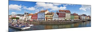 Tourists in a Tourboat with Buildings Along a Canal, Nyhavn, Copenhagen, Denmark--Mounted Photographic Print
