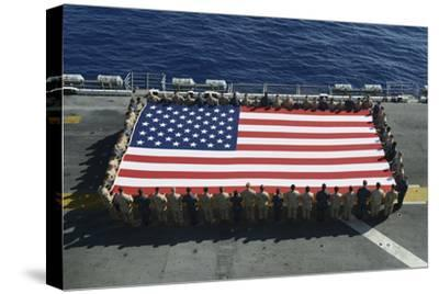 Sailors and Marines Display the National Ensign Aboard USS Kearsarge--Stretched Canvas Print