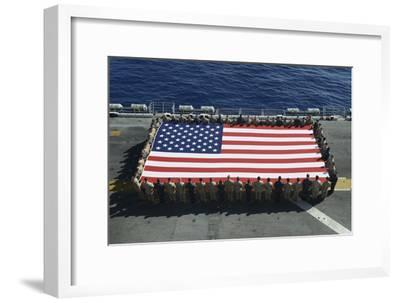 Sailors and Marines Display the National Ensign Aboard USS Kearsarge--Framed Photographic Print