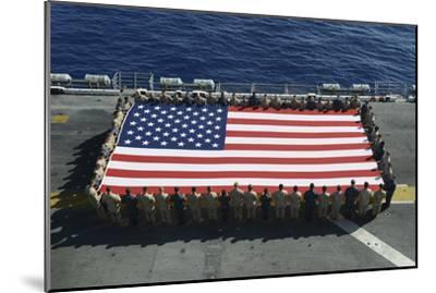 Sailors and Marines Display the National Ensign Aboard USS Kearsarge--Mounted Photographic Print