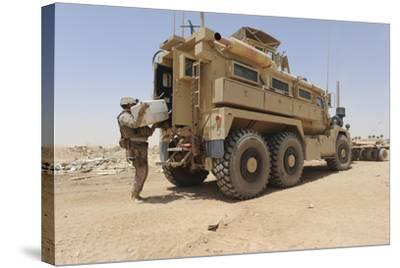 Hospital Corpsman Loads Up a Mine Resistant Ambush Protected Vehicle--Stretched Canvas Print