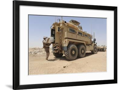 Hospital Corpsman Loads Up a Mine Resistant Ambush Protected Vehicle--Framed Photographic Print