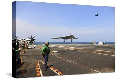An X-47B Unmanned Combat Air System Makes an Arrested Landing--Stretched Canvas Print