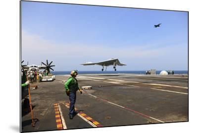 An X-47B Unmanned Combat Air System Makes an Arrested Landing--Mounted Photographic Print