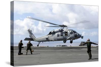 An Mh-60S Sea Hawk Lands on the Flight Deck of USS John C. Stennis--Stretched Canvas Print