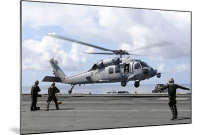 An Mh-60S Sea Hawk Lands on the Flight Deck of USS John C. Stennis--Mounted Photographic Print