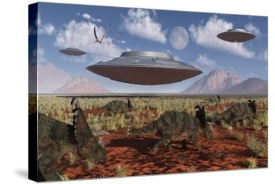A Herd of Centrosaurus Dinosaurs Walk Past a Group of UFO'S--Stretched Canvas Print
