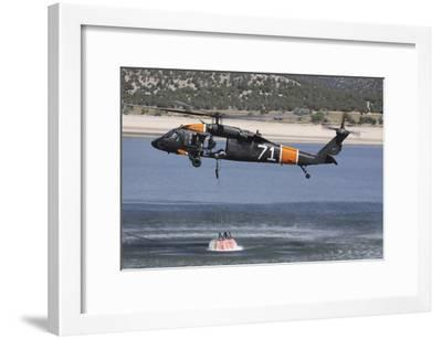 A U.S. Army Uh-60 Black Hawk Helicopter Collects Water from a Reservoir--Framed Photographic Print