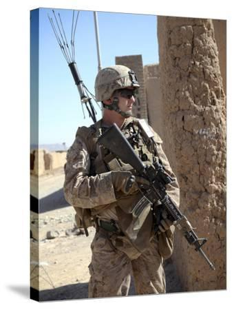 U.S. Marine Provides Security During a Vehicle Checkpoint--Stretched Canvas Print