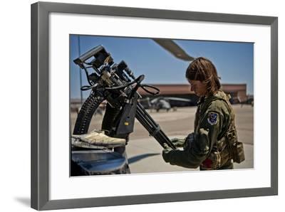 Airman Examines the Barrels of a Gau-2 Mini Gun on an Hh-60 Pave Hawk--Framed Photographic Print