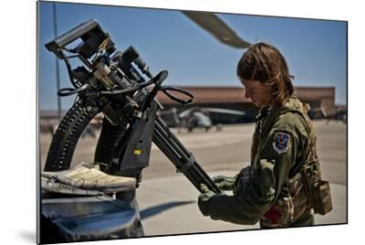 Airman Examines the Barrels of a Gau-2 Mini Gun on an Hh-60 Pave Hawk--Mounted Photographic Print